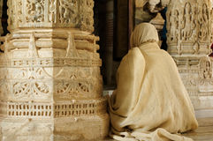 Praying monk insaid the Jain temple in India Royalty Free Stock Images
