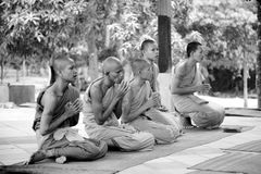Praying monks Stock Image