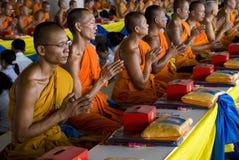 Praying Monks stock images
