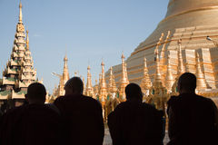 Praying monks at Schwedagon pagoda Royalty Free Stock Photo