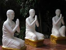 Praying Monks Stock Photo