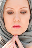 Praying moslem woman close-up portrait Stock Photos