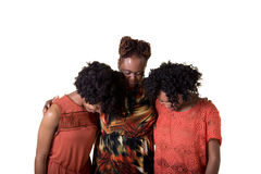 Praying. A mother and her daughters praying Royalty Free Stock Photography