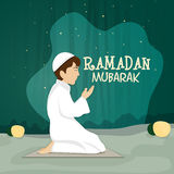 Praying Muslim boy for Ramadan Kareem celebration. Stock Images