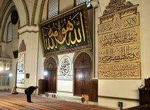 Praying muslim in green mosque Royalty Free Stock Photos