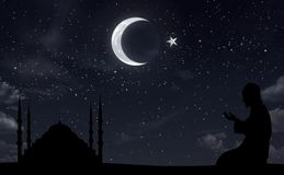 Muslim and mosque at night sky royalty free stock image