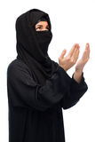 Praying muslim woman in hijab over white Stock Image