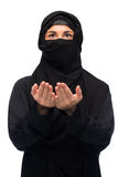 Praying muslim woman in hijab over white Stock Photo