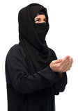 Praying muslim woman in hijab over white Stock Photography