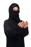Praying muslim woman in hijab over white Royalty Free Stock Photos