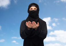 Praying muslim woman in hijab over white Royalty Free Stock Images