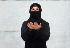 Praying muslim woman in hijab over white Royalty Free Stock Image