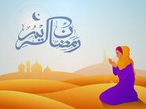 Praying Muslim Woman for Ramadan celebration. Stock Photos