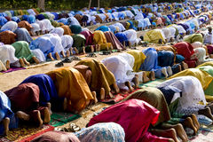Praying Muslims. African Muslims praying during Eid al-Adha.  Also known as Tabaski in West Africa. Africa - The Gambia - Bakau Royalty Free Stock Images