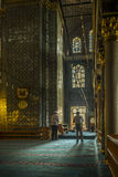 Praying Muslims inside decorative mosque Royalty Free Stock Image