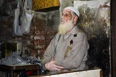 Praying Namaz. An old man praying Namaz in his shop - Old Lahore, Pakistan Royalty Free Stock Images