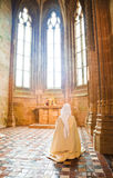 Praying nun. Inside the Abbey of Mont St. Michel, France Stock Images