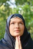 Praying nun Stock Photo