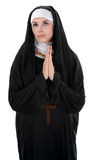 Praying Nun. Innocent nun with palms together in prayer royalty free stock image