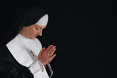 Praying nun Stock Image