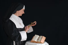 Praying nun Stock Photos