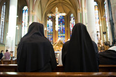 Praying nuns royalty free stock photo