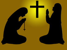 Praying nuns silhouette Royalty Free Stock Photo