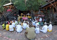 Praying in Nyegara-gunung ceremony Royalty Free Stock Photo