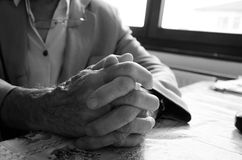 Praying old hands in black and white Stock Photography