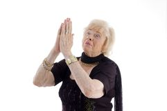 Praying old woman Royalty Free Stock Photo