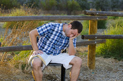 Praying outdoors with a Bible Royalty Free Stock Photography