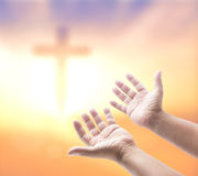 Praying over blurred the cross Royalty Free Stock Images