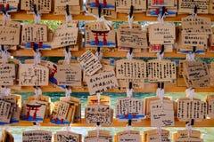 Praying papers at Miyajima temple in Hiroshima, Japan Royalty Free Stock Images
