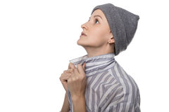 Praying pauper with headdress Royalty Free Stock Photo