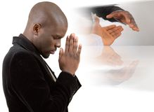 Praying for Peace. This is an image of a businessman praying for success. This image can be used to represent Praying for Peace or Praying for a Deal etc Royalty Free Stock Image