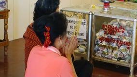 Praying people stock video