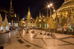 Praying people at Schwedagon pagoda Royalty Free Stock Photos