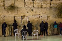 praying people at the western wall in the evening Jerusalem travel stock photography