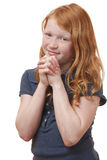 Praying. Portrait of a praying young girl on white background Stock Images