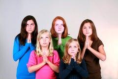 Praying Preteens. Diverse group of cute young girls praying Royalty Free Stock Photo