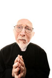 Praying Priest. Funny Priest with Hands Folded in Prayer Royalty Free Stock Photography