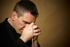 Praying priest royalty free stock photography
