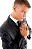 Praying professional looking at camera Stock Photography