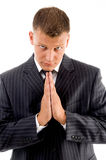 Praying professional looking at camera Stock Photo