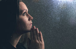 Praying in the rain Stock Photography