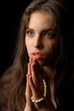 Praying of repentant woman Royalty Free Stock Image