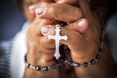 Praying with a rosary Stock Image