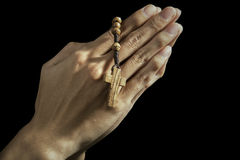 Praying with a rosary Stock Photography