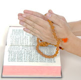 Praying with a rosary Stock Images