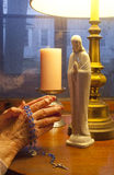 Praying The Rosary Royalty Free Stock Images